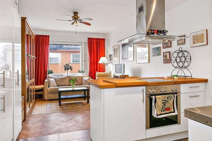2-sala-pequena-cozinha-cortina-vermelha